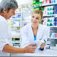 pharmacist talking to her customer