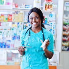 pharmacist holding some medicines