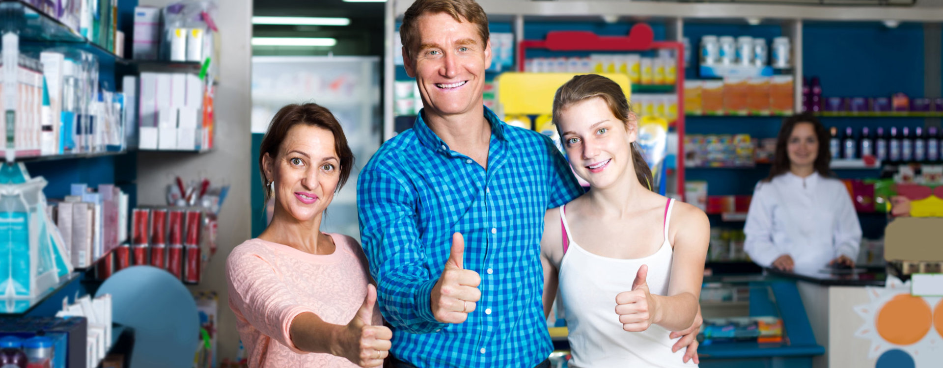 portrait of happy parents with daughter teenager looking satisfied in drug store